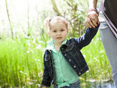 Mother and daughter in forest — Stock Photo