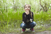 Adorable laughing child in forest — Stock Photo