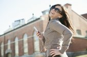 Young beauty posing over city background — Stock Photo