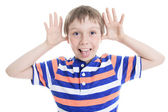 Little boy wincing on white background — Stock Photo