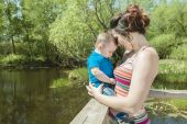 Beautiful mother and little baby boy in forest — Stock Photo