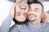 A homosexual couple over a white background — Stock Photo