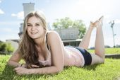 Photo of woman laying in a grass field  — Stock Photo