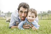 Happy joyful father having fun with is child — Stock Photo