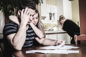Men with financial stress at home — Stock Photo