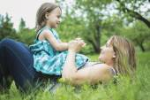 Mother and daughter in forest having fun — Stock Photo