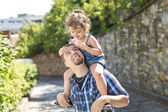 Little Girl with is great father having fun — Stock Photo