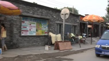 Neighborhood in China With Traffic and Store Fronts — Stock Video