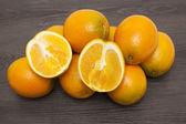 Fresh oranges On wood background — Stock Photo