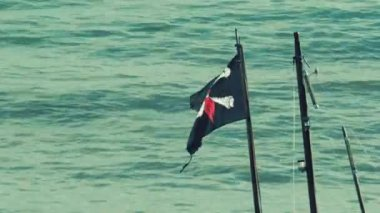 Pirate Flag Blows Around In Wind — Stock Video