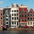 Car Passes Typical Dutch Houses By Canal — Stock Video #66879859
