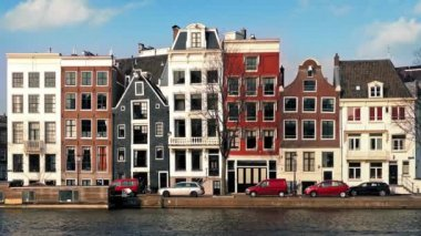 Car Passes Typical Dutch Houses By Canal — Stock Video