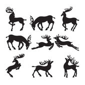 Collection of silhouettes of deer in different positions. — Stock Vector