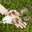 Hand holding feathers — Stock Photo #58875385