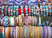 Colorful bracelets and necklaces with beads — Stock Photo