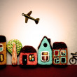 Little toy city. houses, real estate, bicycle, airplane. — Stock Photo #69267899