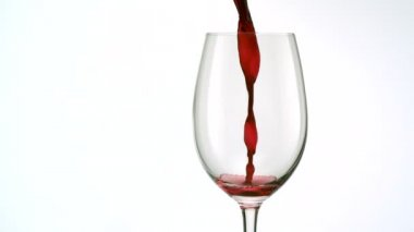 Red wine poured into glass — Stock Video