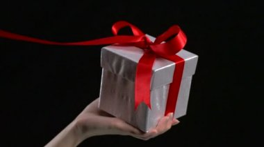 Red ribbon unwrapped from present — Stock Video