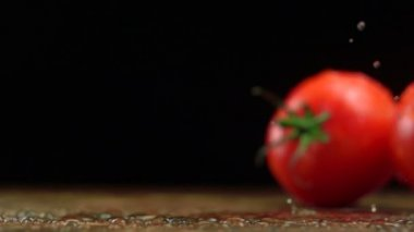 Tomatoes on wooden table — Stock Video