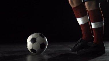 Foot kicking soccer ball — Stock Video