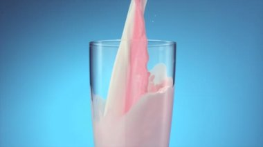 Milk and strawberry milk pouring — Stock Video