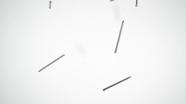 Nails falling in the air — Vidéo