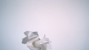 Crushed paper flying in air — Vídeo de Stock