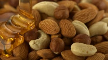 Honey on almond and nuts — Stockvideo