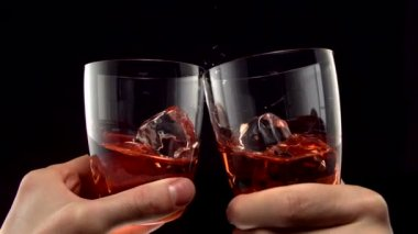 Two glasses of whiskey toasting — Stock Video