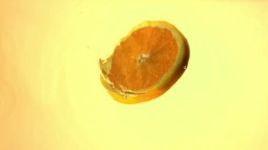 Sliced orange spinning in water — Video Stock