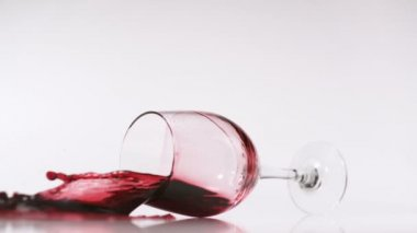 Red wine splashing out of glass — Stock Video