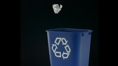 Tossing paper into trash can — Stockvideo