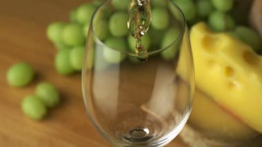 Pouring white wine into glass — Stock Video
