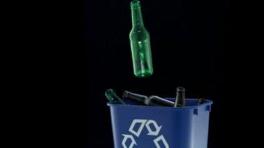 Tossing empty glass bottle — Stock Video