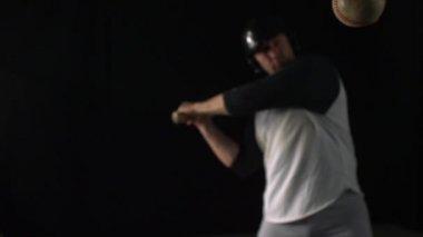 Baseball player hitting ball with bat — Stock Video