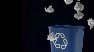Tossing papers into trash can — Stok video