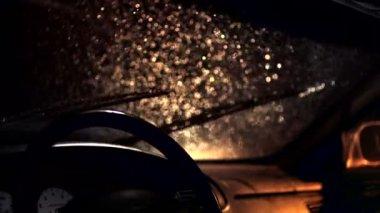 Windshield wiper in rain at night — Wideo stockowe