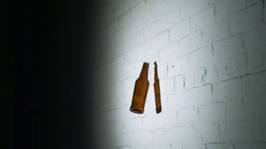 Smashing empty glass bottle on brick wall — Stockvideo