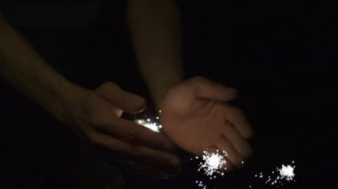Sparkler coming out of hands — Stock Video
