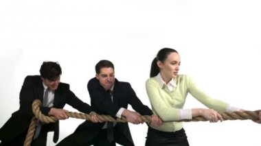 Businessmen and woman playing tug-of-war — Stock Video