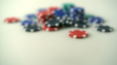 Throwing dice in front of casino chips shooting — Stok video