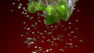 Celery pieces falling in water — Stock Video