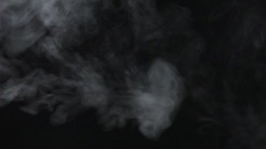 Smoke coming out on black background — Stock Video