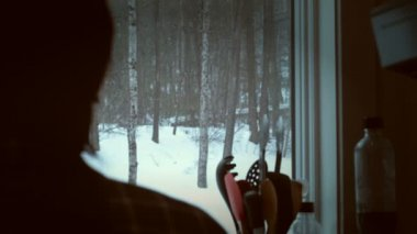 Snow falling through window — Stock Video