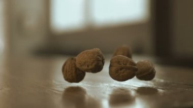 Walnuts falling on table — Stock Video