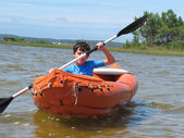 Family with paddle and kayak — Stock Photo