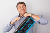 Man with a computer keyboard around his neck — Stock Photo