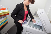 Woman at work in the office — Stock Photo