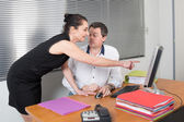 Portrait of a man and a woman at work — Stock Photo