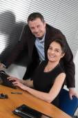 Man and woman at work — Stock Photo